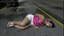 OMG!!! Girl lying on the Road