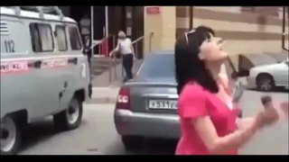 firefighter save a girl from jumping off a building in Russia