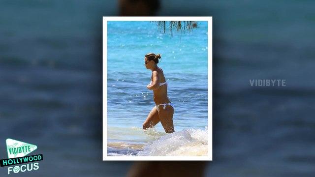 Kimberley Walsh Shows off her Pert Posterior in White Bikini