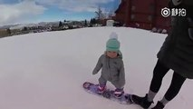This heart-warming video of a 14-month-old baby  trying snowboarding for the first time in her life and totally enjoying