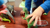 Dinosaur toys fighting and falling by Dudes in Toyland
