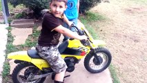Little kid runs staight into fence with dirt bike - Try not to laugh or grin