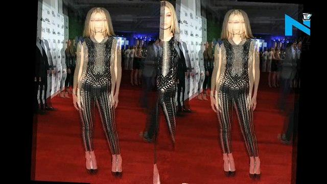 Super Model Gigi Hadid shows off her incredible body in a see-through Bodysuit