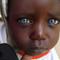 Une enfant noire aux yeux bleus
