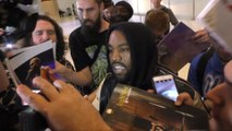 Kanye West Is Barraged By Fans And Paparazzi
