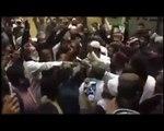 Pervaiz Rasheed hit with shoes at Karachi airport