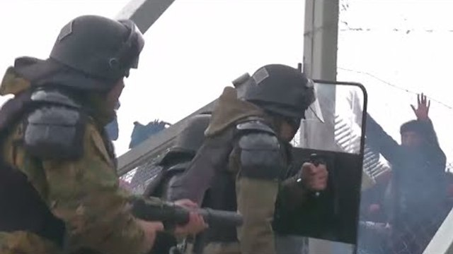 Chaos as police teargas migrants tearing down fence at Greek-Macedonian border