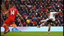 Manchester Uniteds Phil Jones goes wild in the Anfield stands as Wayne Rooney bags winner