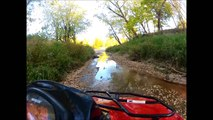 Doing a little mud bogging in the creek with my brand spankin new Arctic Cat