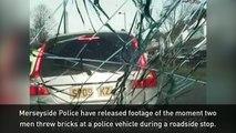 Dashcam video: Men throw bricks at a police car