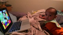 Baby watching the hot dog song of Mickey mouse