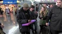Kanye West gets creative sketching a fans portrait at JFK