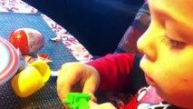 Little boy opens Kinder surprise eggs