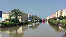 Vehicles half-submerged on Dubai's flooded streets