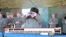 N. Korean leader presides over test-fire of new multiple rocket launcher