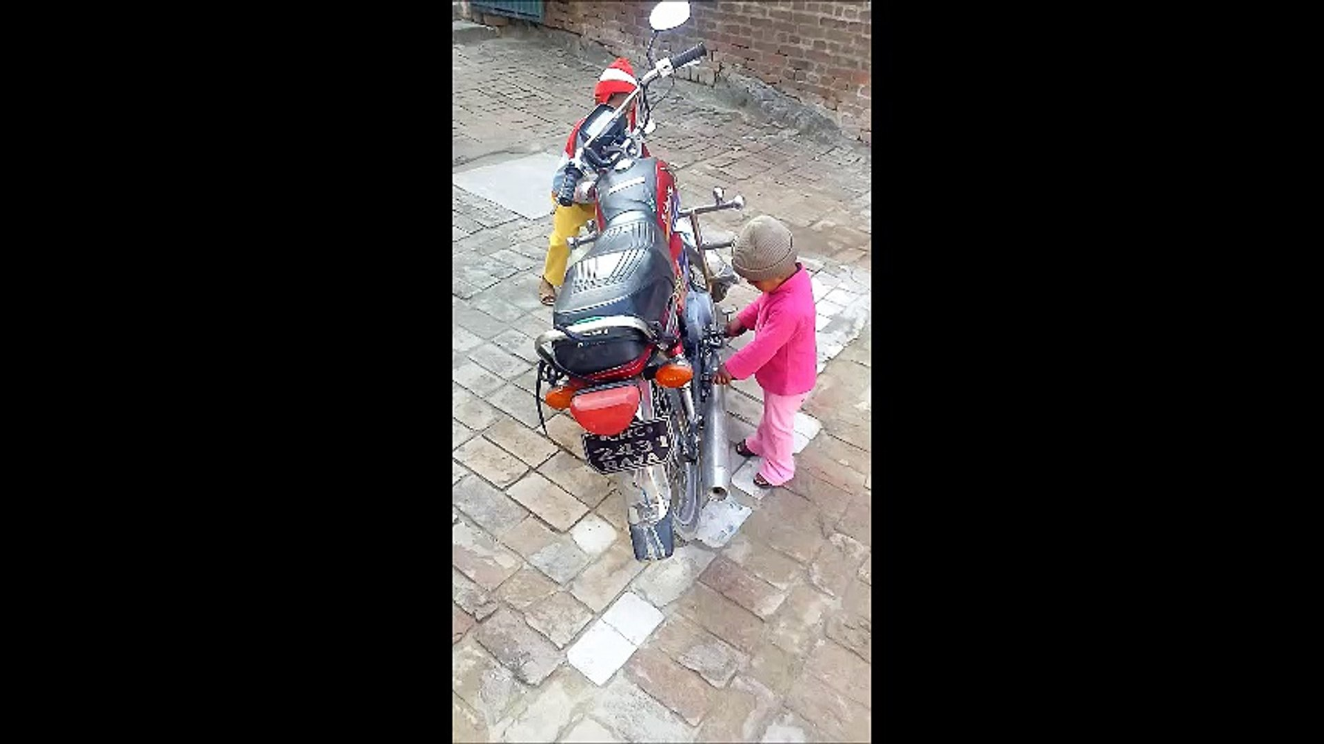 Kids Playing with a Bike