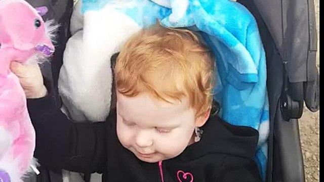 Baby girl playing with unicorn