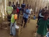 Touring a classroom made out of bamboo sticks at Faith Orphanage in Grand Bassa County, Liberia