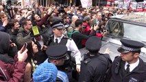 Scuffles as protesters force Tories from their vehicle in London