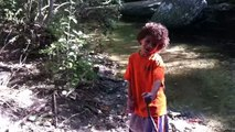 Jorian dancing on the creek being silly