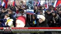 """Proteste la Moscova, la un an de la asasinarea unuia dintre liderii opoziţiei ruse, Boris Nemţov. """"O Rusie fără Putin"""", """"Nu vom uita, nu vom ierta"""", """"Nu anexării Crimeei"""" sau """"Rusia trebuie să fie liberă""""."""
