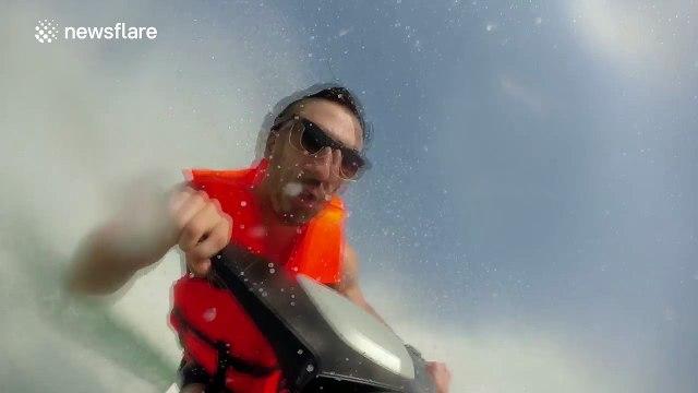 Man falls off jet-ski very suddenly