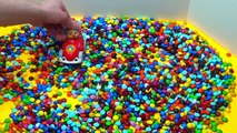 Lets play with M&Ms and make a candy mess! Sesame Streets Cookie Monster and Elmo play