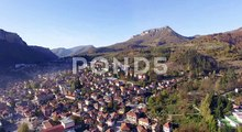 Aerial Flight Above Sunny Mountain Town, 4K, aerial drone