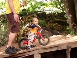 Christopher Jr., 20 months old, Riding a specialized balance bike at the dirt jumps.Part one.