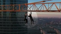 Rock Climbing - Extreme Climbers Hang From Moscow Crane for Illegal Stunt 2016