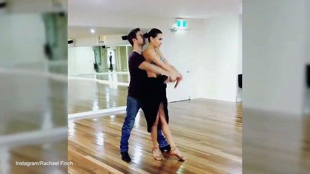 Model Rachael Finch twirls in a crop top with dancer husband