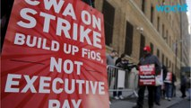 Striking union workers protest at Verizon shareholder meeting