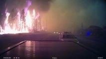 Les canadiens qui quittent calmement Fort McMurray dans les flammes