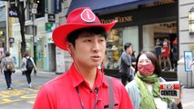Korea's Red Angels hit the streets to help foreign visitors