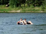 Tubing on a river that runs from Lake McDonald in Glacier National Park, Montana 07/27/2009