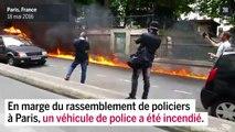 Une voiture de police incendiée en marge de la manifestation à Paris