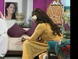 Host Farah Hussain wearing tight brown jeans and sandal heels