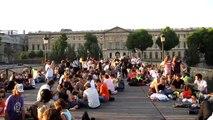 people have gathering and picnic on the bridge, Seine, Paris, 25 June 2010