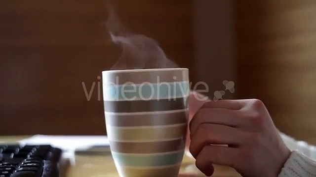 Womans Hand And a Mug Of Coffee On The Table In The Office – Stock | VideoHive 15557445