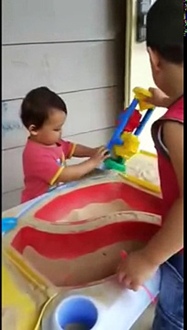 Kids Playing Sand Pit indoor activity fun time