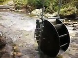 A permanent magnet alternator that's built in with the waterwheel generates free electricity