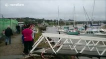 Australian yacht club marina collapses during heavy rains and flood tides