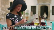 Happy young lady checking city map to find interesting places for sightseeing. Stock Footage