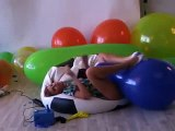 Giantess inflatable balloons17 Electra inflating and playing with 24 inch balloons