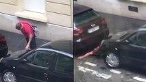 Un supporter ivre urine entre deux voitures avant de tomber dedans !
