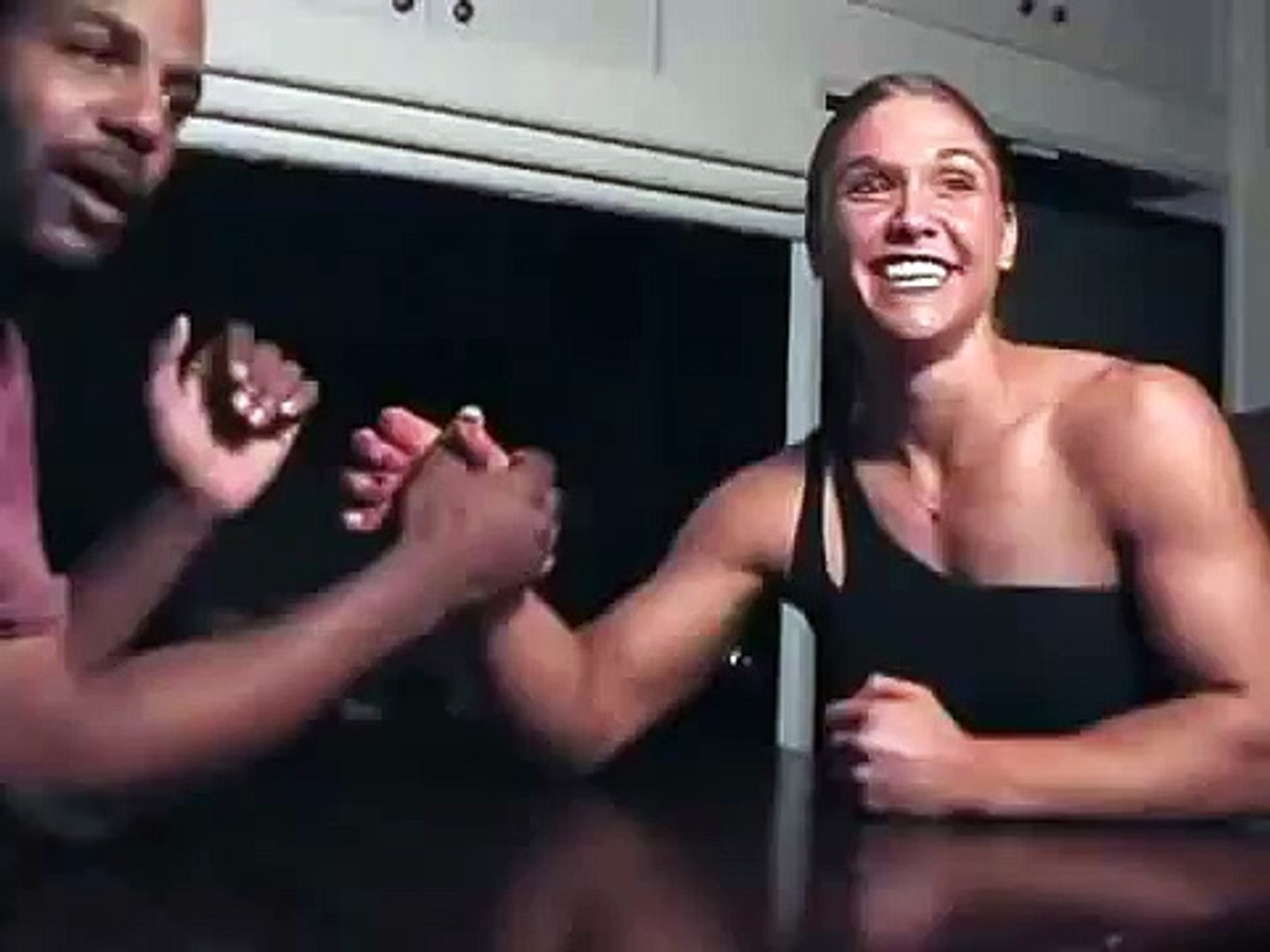 Girl With Muscles Armwrestling Guy