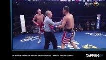Un arbitre reçoit une énorme droite de la part d'un boxeur