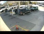 Guy at Gas Station Gets Knocked Down and almost Run Over by Pickup truck