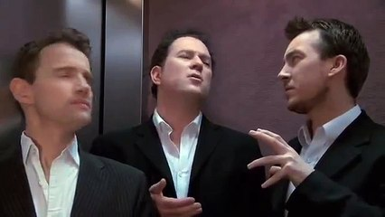 Three sommeliers in a lift