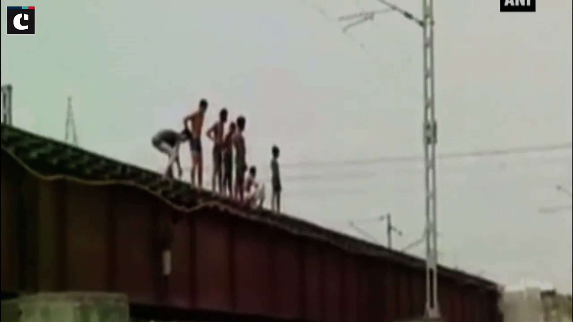 Young boys jump off bridge seconds before train passes through